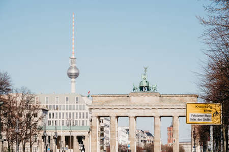 BERLIN, GERMANY - 04.04.2020: View on the Brandenburg Gate and TV-Tower in the center of Berlin.