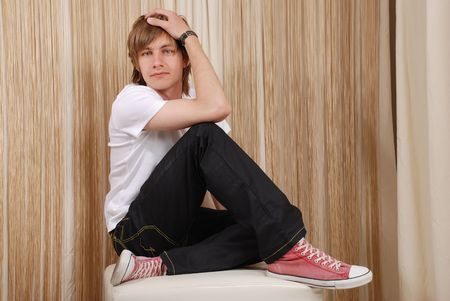 young man in pink boots poses photo