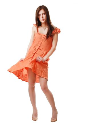 casual dress: brunette girl in the orange dress isolated on a white background Stock Photo