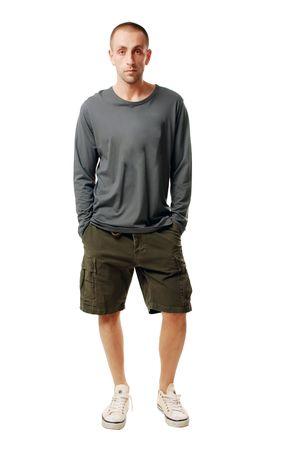 sandalia: un hombre joven feliz en pantalones cortos y una camiseta sobre un fondo blanco Foto de archivo