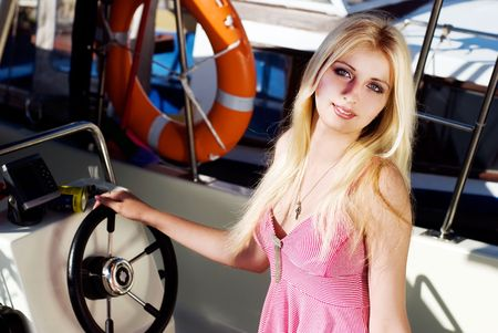 beautiful blonde girl on the boat