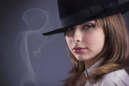 studio portrait of a girl in a top hat photo