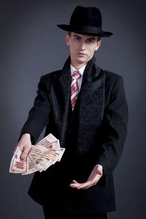 studio portrait of business men in the top hat. offers of money. photo