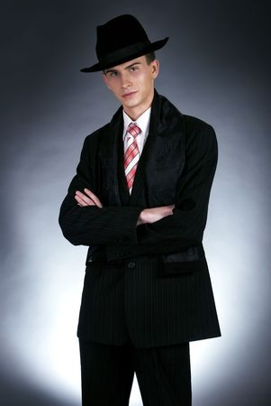 studio portrait of a serious man in top hat photo