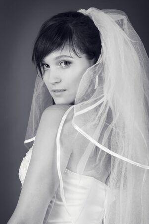 black and white studio portrait of a happy bride photo
