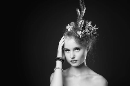 black and white portrait of a Woman with cactus in her hair on a black background photo