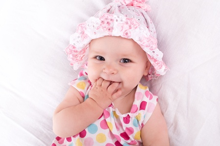 girl in a hat: Portrait of a baby girl  on a white background