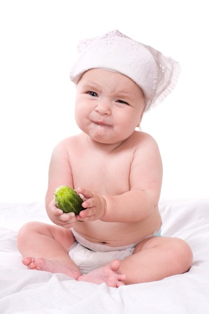 angry vegetable: Portrait of a baby girl  on a white background