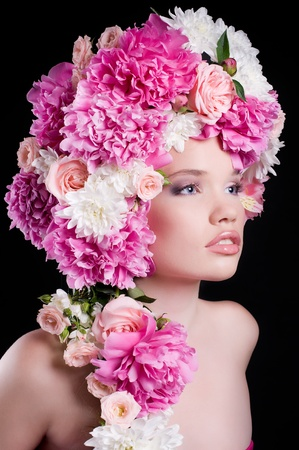 Beautiful young woman with peony flower photo