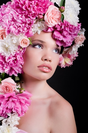 Beautiful young woman with peony Stock Photo - 10732849