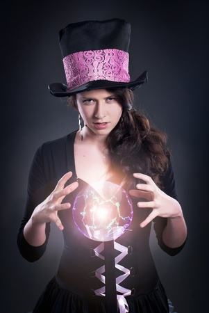 Wizard with glowing magical ball photo