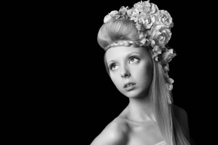 monochrome portrait of a beautiful young girl with flowers in their hair Stock Photo - 10732534