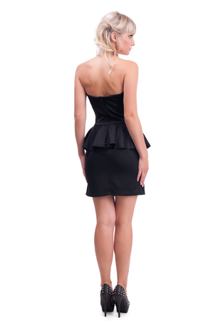 portrait of a beautiful girl in a little black dress isolated on white background