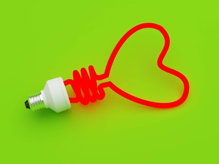 Energy saving lamp in the shape of the heart photo