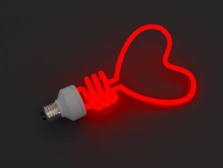 adore: Energy saving lamp in the shape of the heart Stock Photo