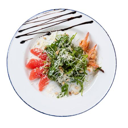 Salad with arugula and shrimp on a white background isolated. Photo taken from above.