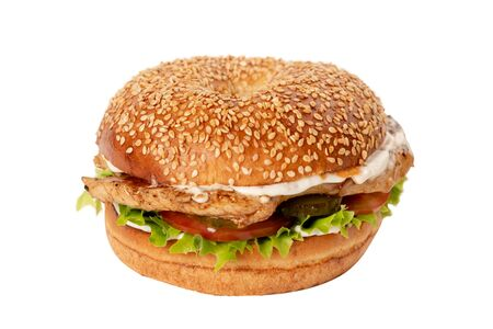 Juicy Burger on white isolated background. Bun with sesame seeds. The theme of eating fast food Imagens - 124967237