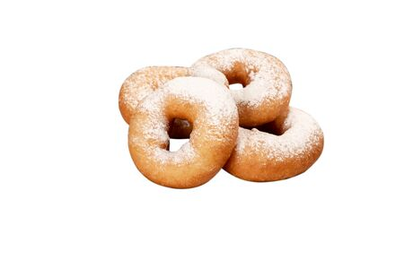 Juicy fresh donuts covered with powdered sugar on a white background isolated without a plate. Фото со стока