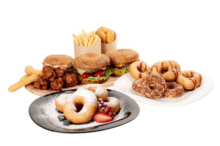 ingredients hamburger, French fries, donuts, nuggets, cheese sticks and chicken legs on white isolated background, concept