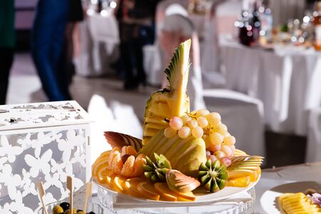 a plate of fresh fruit on the Banquet table in the restaurant