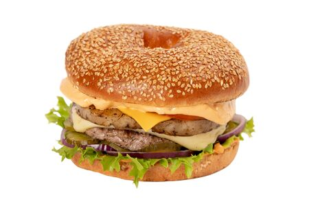 Juicy Burger on white isolated background. Bun with sesame seeds. The theme of eating fast food