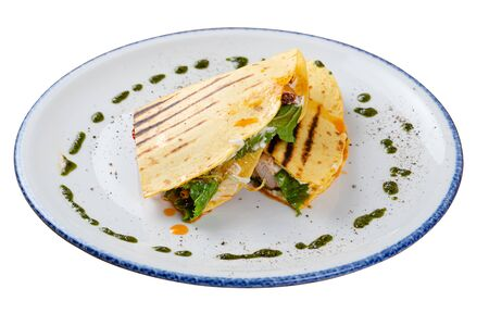 Quesadilla with chicken on a white plate, side view. White isolated background. 版權商用圖片