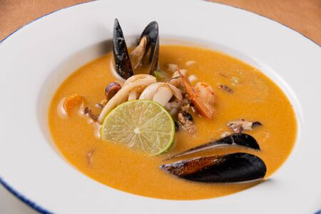 Soup of stewed mussels in a white deep plate close-up Stok Fotoğraf