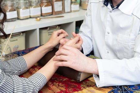 description: Pulse diagnostic on a tibetan medicine