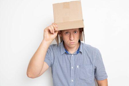 man puts a bag on his head