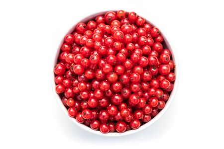 red currant in a white bowl on a white isolated background