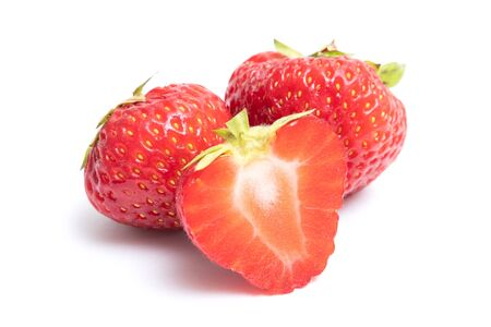 Isolated strawberries. Two whole strawberry fruits and half isolated on white background, with clipping path Imagens