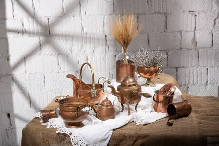 still life with a set of old antique copper utensils