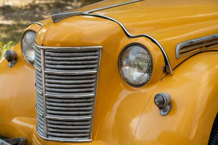Antique retro yellow car close-up