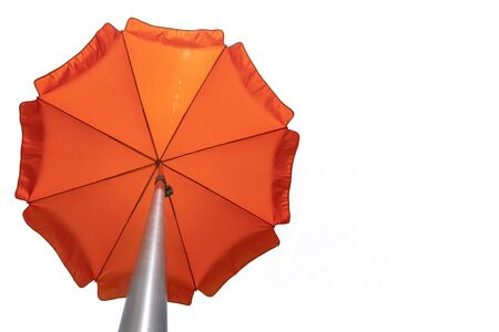 Orange beach umbrella isolated on white. Clipping path included. Copy space