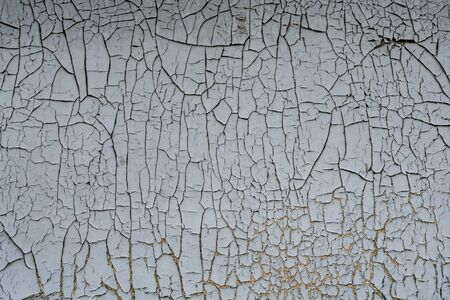 Rusty metal background with flaking,cracking blue gray paint cover.Industrial close up background. 免版税图像