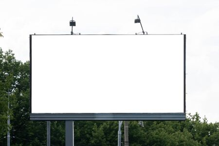 The large blank billboard with the sky, ready to use for new mockup advertisement, marketing street media and backgroud concept Imagens