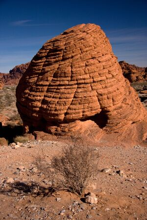 derives: The Valley of Fire derives its name from red sandstone formations, formed from great shifting sand dunes during the age of dinosaurs. Complex uplifting and faulting of the region, followed by extensive erosion, have created the present landscape.