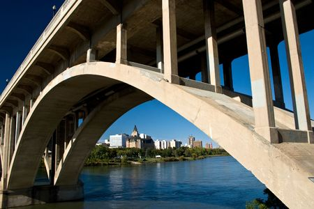 Downtown Saskatoon as seen under the Broadway Bridge on the South Saskatchewan River. photo