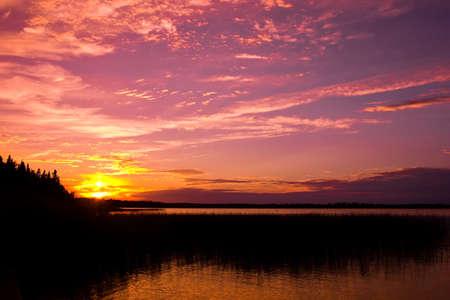 A sunset on a Madge Lake in Saskatchewan, Canada.