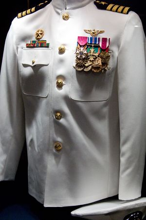 The captains uniform on display on the USS Midway Aircraft in San Diego, California photo