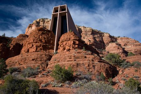 catholic chapel: The Chapel of the Holy Cross is a Catholic chapel belonging to the Parish of Saint John Vianney and the Roman Catholic Diocese of Phoenix. It was built directly into a butte and offers a spectacular view of the valley 200 feet below.