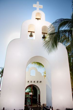 A white church that can be found downtown on 5th Avenue near the port to Cozumel. photo