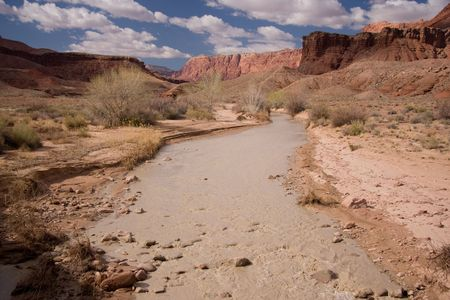 The Paria River leads through the Lonely Dell Ranch to the Colorado River at the start of the Grand Canyon. Stock Photo - 4902549