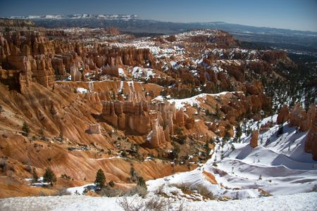 Bryce Canyon is famous for its unique geology of red rock spires and horseshoe-shaped amphitheaters, Bryce offers the visitor a Far View from the eastern edge of the Paunsaugunt Plateau in southern Utah. photo
