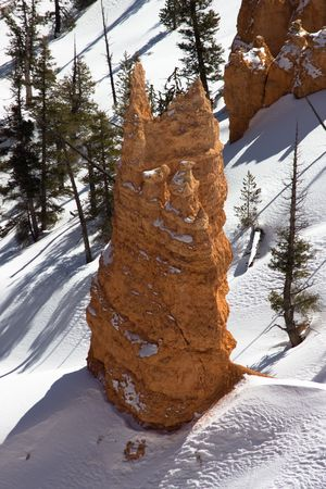 hoodoo: A Bryce Canyon Hoodoo found in great contrast with the winter snow.