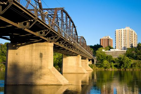 The old Victoria Bridge over the South Saskatchewan River in Saskatoon, Saskatchewan, Canada. photo