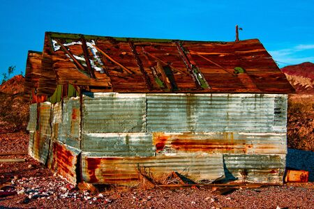 An old shed found in the ghost town Rhyolite, Nevada.  Image has been enhanced in Lightroom. Stock Photo