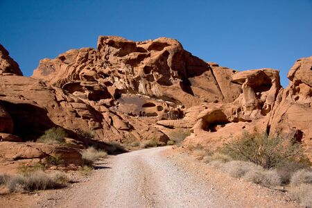 derives: The Valley of Fire derives its name from red sandstone formations Stock Photo