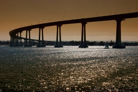 referred: The San Diego-Coronado Bridge, locally referred to as the Coronado Bridge, is a prestressed concretesteel girder bridge, crossing over San Diego Bay in the United States, linking San Diego, California with Coronado, California.
