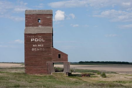 One of the few remaining Saskatchewan landmarks, wooden grain elevators used to dot the prairie landscape but most have been torn down and replaced by concrete terminals. photo